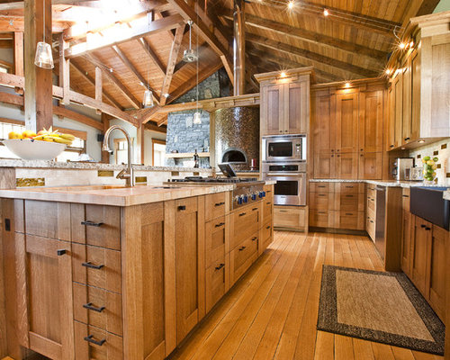 Rustic Kitchen Idea In Calgary With Wood Countertops