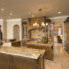 Mediterranean Kitchen by Peterson Homebuilders, Inc.