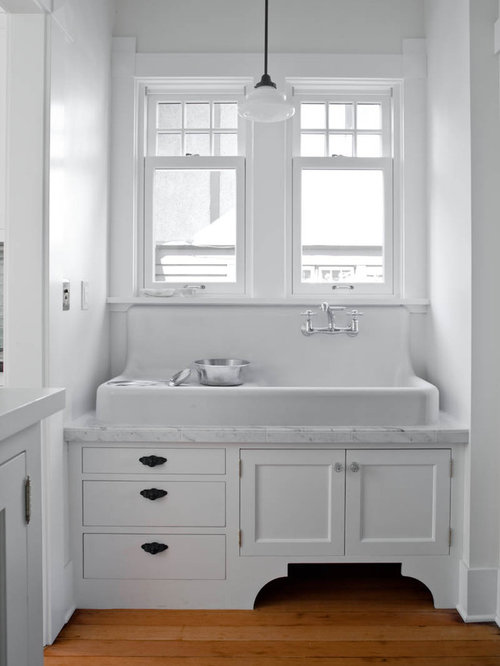 Traditional Kitchen Idea In Seattle With A Farmhouse Sink, Recessed Panel  Cabinets And White