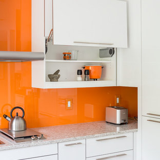 Mid-sized modern eat-in kitchen photos - Eat-in kitchen - mid-sized modern cork floor eat-in kitchen idea in Toronto with a double-bowl sink, flat-panel cabinets, white cabinets, quartz countertops, orange backsplash, glass sheet backsplash, stainless steel appliances and a peninsula