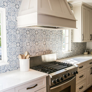 Mid-sized farmhouse eat-in kitchen appliance - Mid-sized country single-wall brown floor and medium tone wood floor eat-in kitchen photo in Atlanta with gray cabinets, blue backsplash, terra-cotta backsplash, stainless steel appliances, an island, a drop-in sink, shaker cabinets and quartz countertops