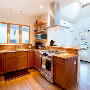 Small craftsman enclosed kitchen inspiration - Enclosed kitchen - small craftsman u-shaped light wood floor and brown floor enclosed kitchen idea in San Francisco with an undermount sink, shaker cabinets, medium tone wood cabinets, red backsplash, stone slab backsplash, stainless steel appliances, a peninsula and granite countertops