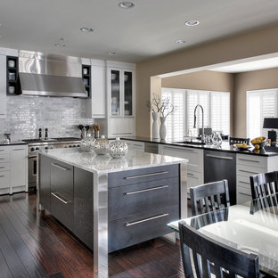 Eat-in kitchen - large contemporary u-shaped dark wood floor eat-in kitchen idea in DC Metro with stainless steel appliances, an undermount sink, shaker cabinets, white cabinets, marble countertops, white backsplash, an island and marble backsplash