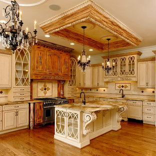 Large mediterranean kitchen ideas - Example of a large tuscan l-shaped medium tone wood floor and brown floor kitchen design in DC Metro with an undermount sink, raised-panel cabinets, beige cabinets, marble countertops, beige backsplash, stone tile backsplash, paneled appliances and an island