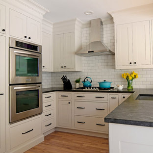 Design ideas for a small classic u-shaped kitchen/diner in New York with a submerged sink, shaker cabinets, beige cabinets, granite worktops, white splashback, stainless steel appliances, a breakfast bar and metro tiled splashback.