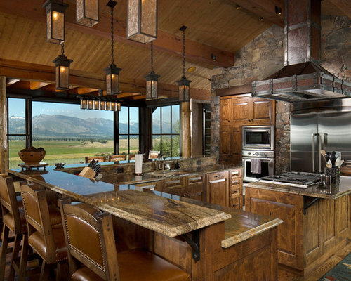 Inspiration For A Large Rustic L Shaped Dark Wood Floor And Brown Floor Eat