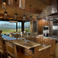 Rustic Kitchen by Rocky Mountain Log Homes