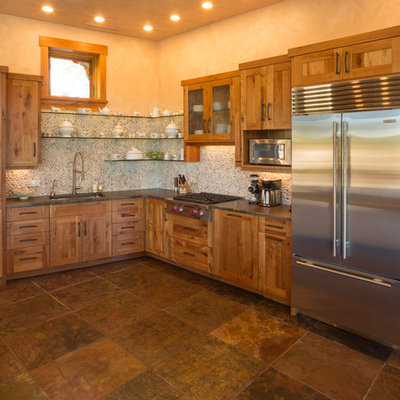 Kitchen - rustic l-shaped kitchen idea in Denver with an undermount sink, shaker cabinets, medium tone wood cabinets and stainless steel appliances