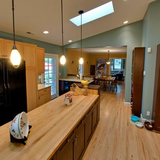 Large traditional kitchen inspiration - Inspiration for a large timeless single-wall medium tone wood floor kitchen remodel in Baltimore with light wood cabinets, wood countertops and an island