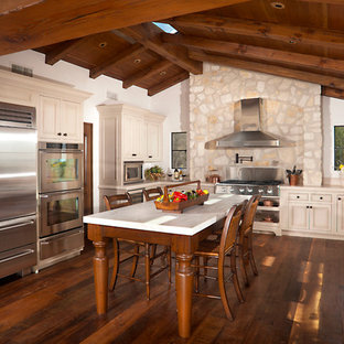Large traditional kitchen pictures - Large elegant u-shaped dark wood floor kitchen photo in Orange County with stainless steel appliances