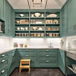 This is an example of a large country galley separate kitchen in Austin with open cabinets, white splashback, concrete floors, blue cabinets, marble benchtops, subway tile splashback, stainless steel appliances, with island, grey floor and white benchtop.