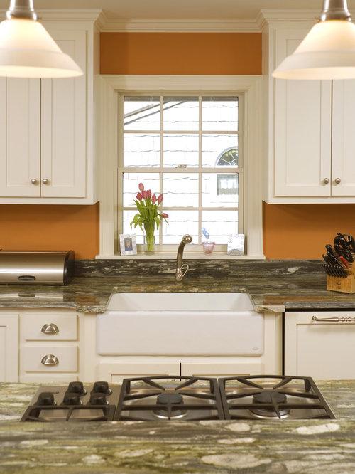 kitchen with orange backsplash and stone slab backsplash design ideas