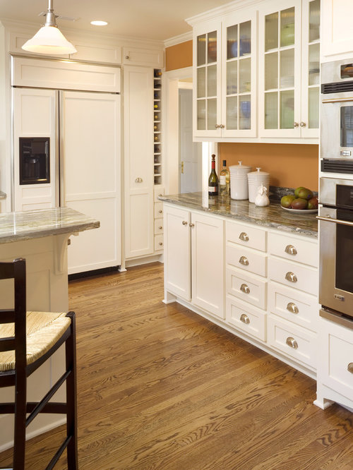 Kansas city kitchen design ideas renovations photos with yellow cabinets for Kitchen cabinets kansas city