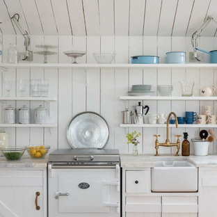 Photo of a small shabby-chic style single-wall kitchen in Cornwall with a farmhouse sink, white cabinets, marble benchtops, white appliances, no island, white benchtop, open cabinets, white splashback and timber splashback.