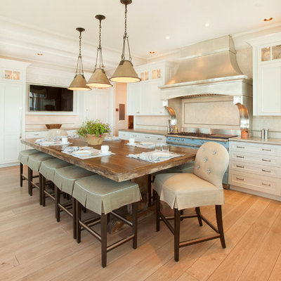 Kitchen - transitional kitchen idea in Omaha with recessed-panel cabinets, white cabinets and colored appliances