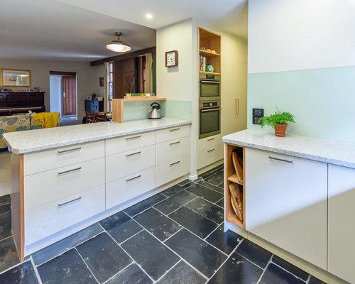 Cucina con top in laminato e pavimento in ardesia - Foto e Idee per ...