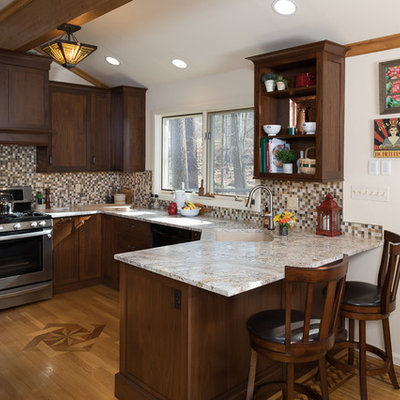 Small arts and crafts u-shaped medium tone wood floor enclosed kitchen photo in Philadelphia with an undermount sink, shaker cabinets, brown cabinets, granite countertops, multicolored backsplash, mosaic tile backsplash, paneled appliances and a peninsula