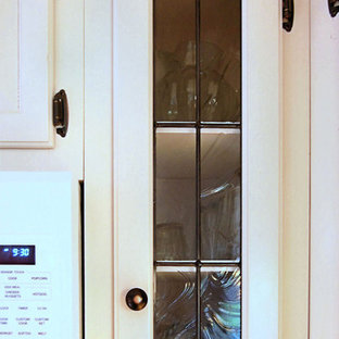 Craftsman kitchen ideas - Kitchen - craftsman kitchen idea in New York with glass-front cabinets
