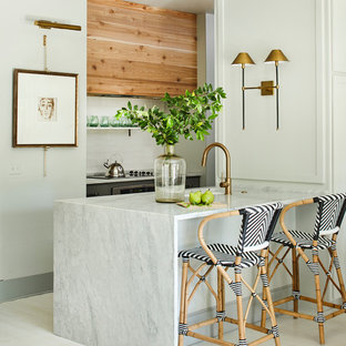 Coastal kitchen inspiration - Inspiration for a coastal white floor kitchen remodel in Other with an undermount sink, white backsplash, subway tile backsplash, stainless steel appliances, a peninsula and white countertops