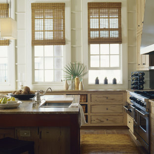 Inspiration for a mid-sized tropical l-shaped open plan kitchen in Miami with a double-bowl sink, beige cabinets, stainless steel appliances, with island, recessed-panel cabinets, granite benchtops and dark hardwood floors.
