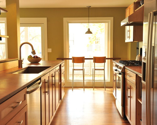 Example of a trendy galley medium tone wood floor eat-in kitchen design in  Portland