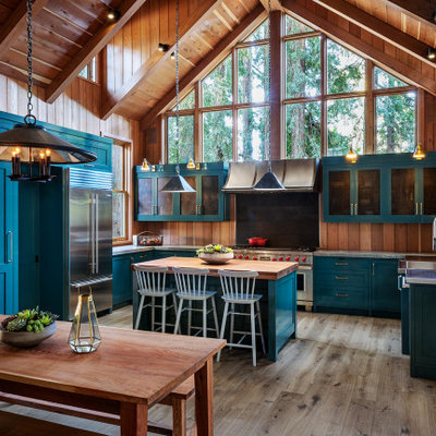 Large mountain style u-shaped medium tone wood floor and gray floor open concept kitchen photo in San Francisco with an integrated sink, shaker cabinets, blue cabinets, granite countertops, stainless steel appliances, an island and gray countertops