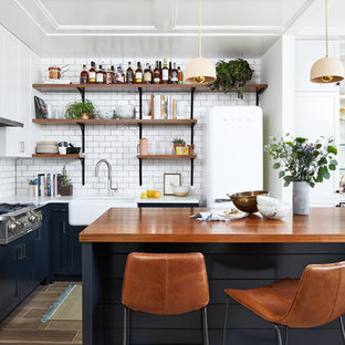 75 Beautiful Kitchen With Blue Cabinets And Wood Countertops