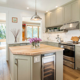 Small elegant l-shaped light wood floor eat-in kitchen photo in San Francisco with an undermount sink, shaker cabinets, gray cabinets, marble countertops, white backsplash, stone tile backsplash, stainless steel appliances and an island
