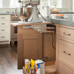 Design ideas for a large transitional l-shaped eat-in kitchen in New York with an integrated sink, shaker cabinets, grey cabinets, limestone benchtops, beige splashback, mosaic tile splashback, stainless steel appliances, dark hardwood floors and with island.