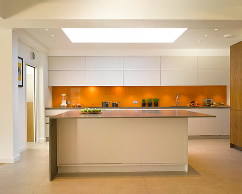 Large contemporary open concept kitchen idea in London with an undermount  sink, flat-panel