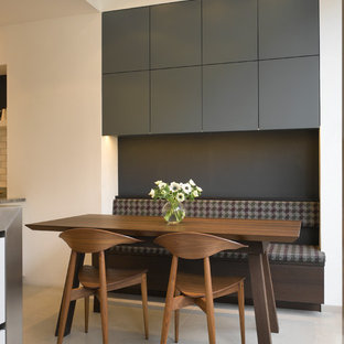 Photo of a large contemporary kitchen/diner in London with flat-panel cabinets and grey cabinets.