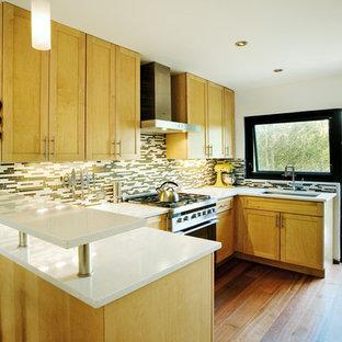 Example of a transitional open concept kitchen design in Denver with shaker cabinets, light wood cabinets, matchstick tile backsplash and multicolored backsplash