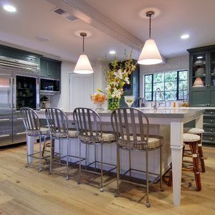 Large traditional l-shaped separate kitchen in Los Angeles with shaker cabinets, green cabinets, mosaic tile splashback, stainless steel appliances, light hardwood floors and with island.