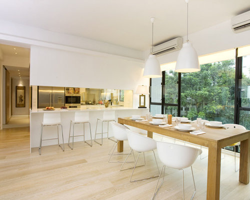 Example Of A Trendy Eat In Kitchen Design In Hong Kong With Stainless Steel  Appliances