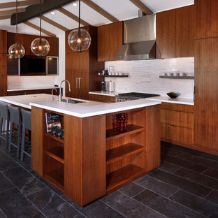 Design ideas for an expansive contemporary l-shaped eat-in kitchen in Los Angeles with an undermount sink, flat-panel cabinets, dark wood cabinets, quartz benchtops, white splashback, matchstick tile splashback, stainless steel appliances, marble floors, with island, blue floor and yellow benchtop.