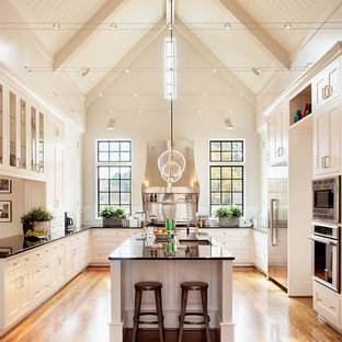 Huge traditional kitchen photos - Huge elegant u-shaped medium tone wood floor kitchen photo