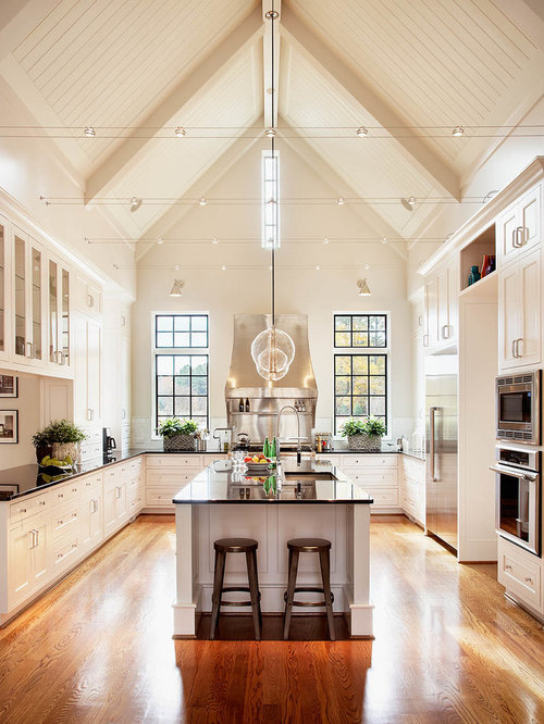track lighting kitchen. Huge Elegant U-shaped Medium Tone Wood Floor Kitchen Photo In Raleigh With Shaker Cabinets Track Lighting