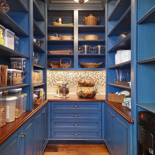Traditional kitchen pantry remodeling - Elegant u-shaped medium tone wood floor kitchen pantry photo in Other with open cabinets, blue cabinets, wood countertops, multicolored backsplash and mosaic tile backsplash