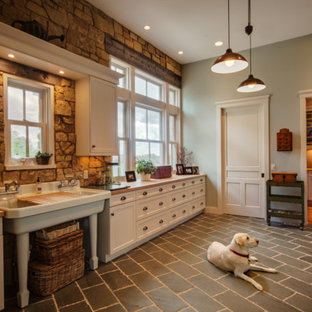 Large arts and crafts galley kitchen pantry in Other with a drop-in sink, shaker cabinets, white cabinets, wood benchtops, beige splashback, stainless steel appliances, stone tile splashback and ceramic floors.