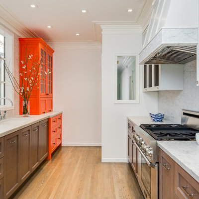 Enclosed kitchen - traditional galley beige floor enclosed kitchen idea in San Francisco with recessed-panel cabinets, dark wood cabinets, white backsplash and stone slab backsplash