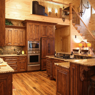 Rustic kitchen designs - Example of a mountain style kitchen design in Charlotte with granite countertops and slate backsplash