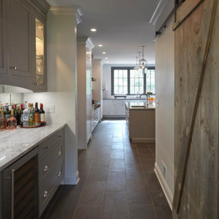 Huge farmhouse kitchen pantry designs - Kitchen pantry - huge cottage porcelain tile and brown floor kitchen pantry idea in Chicago with gray cabinets, marble countertops, mirror backsplash, stainless steel appliances, a double-bowl sink, white backsplash, an island and shaker cabinets