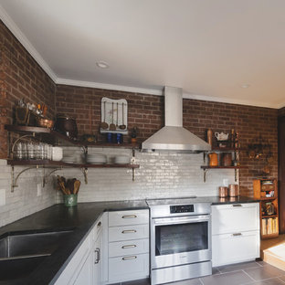 Inspiration for a small country l-shaped separate kitchen in Philadelphia with a double-bowl sink, shaker cabinets, grey cabinets, soapstone benchtops, white splashback, terra-cotta splashback, stainless steel appliances, slate floors, no island, purple floor and black benchtop.