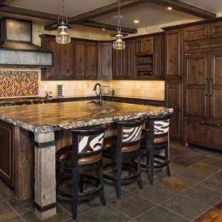 Design ideas for a large rustic kitchen in Other with a submerged sink, granite worktops, integrated appliances, slate flooring, an island, multicoloured worktops, recessed-panel cabinets, dark wood cabinets, multi-coloured splashback and brown floors.