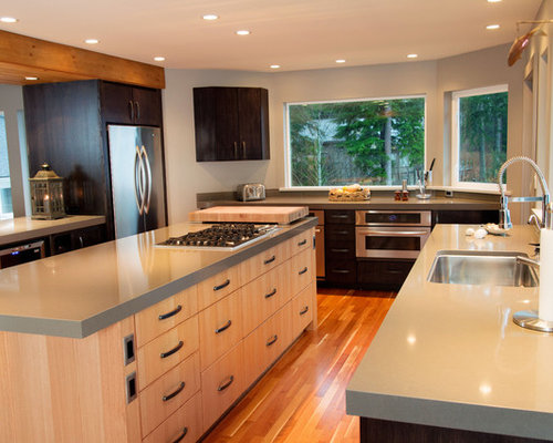 Example Of A Trendy Kitchen Design In Vancouver With An Undermount Sink Flat Panel
