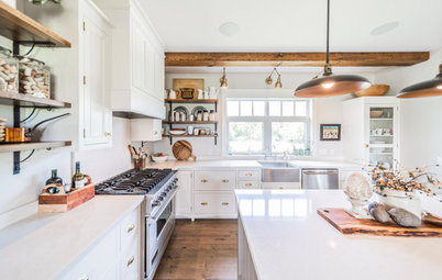 White Farmhouse Kitchen Warmed by Wood and Metal