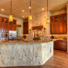 Rustic Kitchen by Garner Homes
