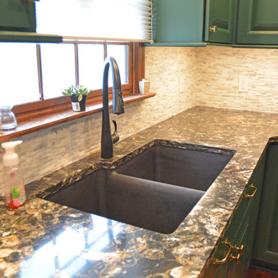 Example of a small transitional l-shaped medium tone wood floor and brown floor eat-in kitchen design in Other with an undermount sink, raised-panel cabinets, green cabinets, quartz countertops, white backsplash, marble backsplash, black appliances, an island and multicolored countertops