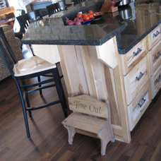 Traditional Kitchen by Premier Custom Woodworks & Rustic Home Interiors