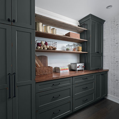 Example of a transitional dark wood floor and brown floor kitchen pantry design in Other with shaker cabinets, wood countertops, white backsplash and brown countertops